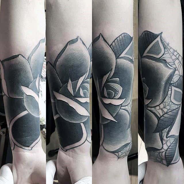 Man With Black Rose Wrist Tattoo