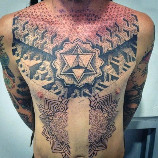 Man With Black Sacred Geometry Tattoo Patterns On Chest