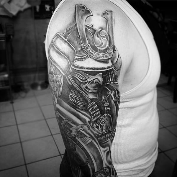 Man With Blackwork Shaded Traditional Samurai Mask Upper Arm Half Sleeve Tattoo