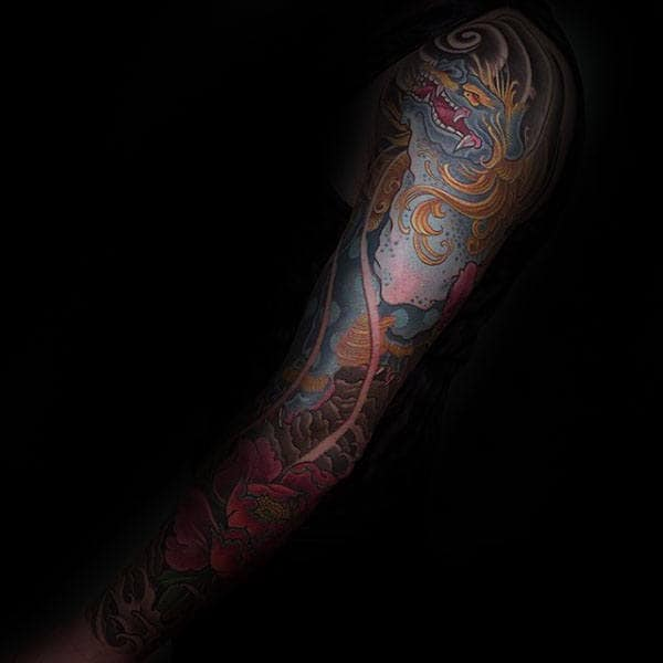 Man With Blue Foo Dog Full Sleeve Tattoo Design