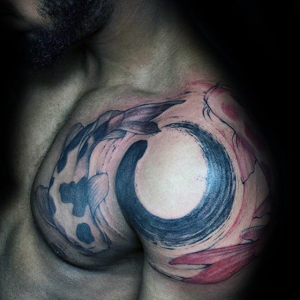 Man With Brush Stroke Fish Shoulder Tattoo