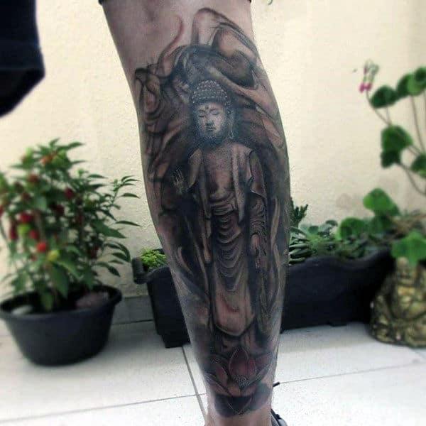 Man With Calm Buddha Tattoo On Lower Legs