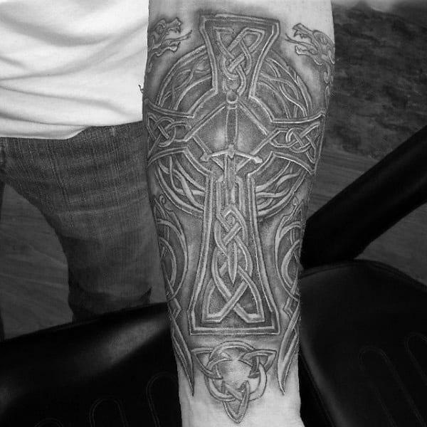 Man With Celtic Cross Forearm Sleeve Tattoo
