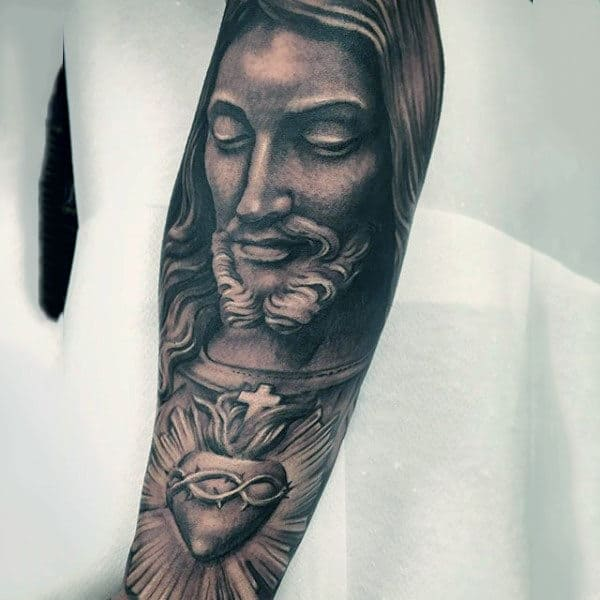 Man With Christian Jesus Heart Forearm Tattoo Black And White Ink
