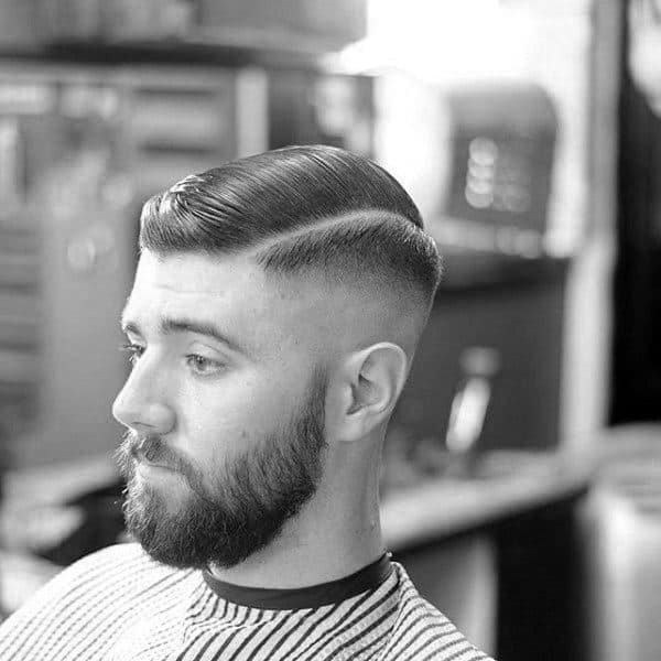 Man With Classic Old School Comb Over Haircut And Skin Fade On Sides Short Length
