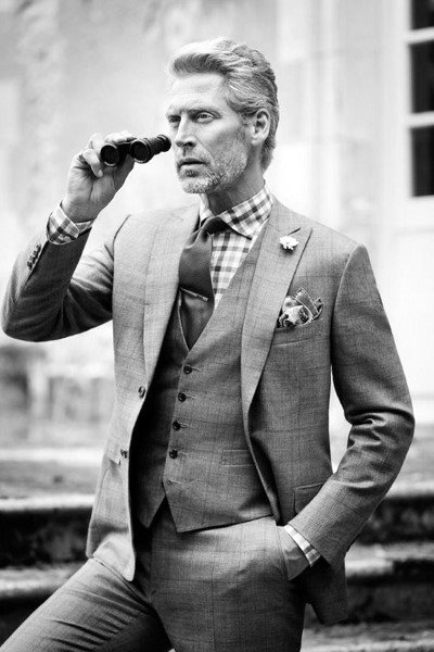 Man With Classy Hairstyle And Three Piece Suit
