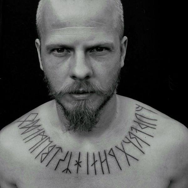 Man With Collar Bone Rune Tattoo