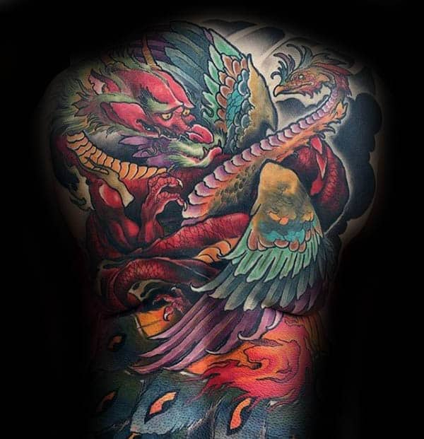 Man With Colorful Full Back Phoenix Themed Tattoo