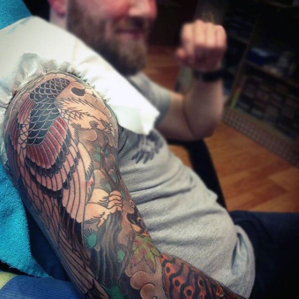 Man With Colorful Hawk Half Sleeve Tattoo