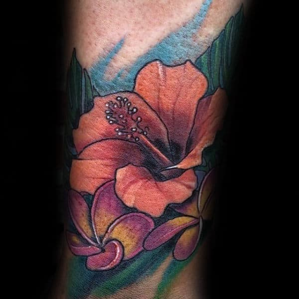Man With Colorful Hibiscus Flower Forearm Tattoo