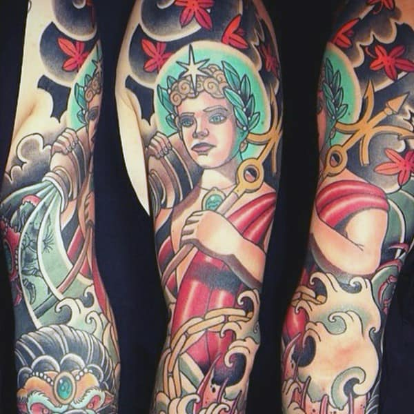 Man With Colorful Japanese Aquarius Sleeve Tattoo