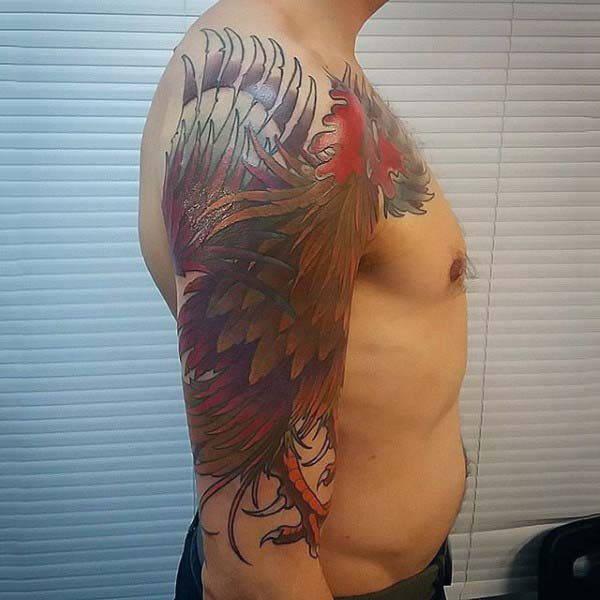 Man With Colorful Rooster Tattoo On Upperarm