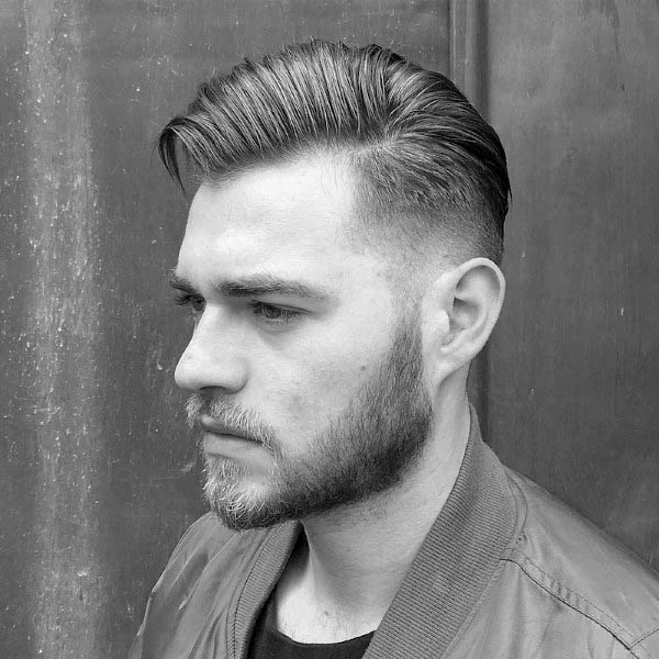 Man With Comb Over Low Fade Hairstyle