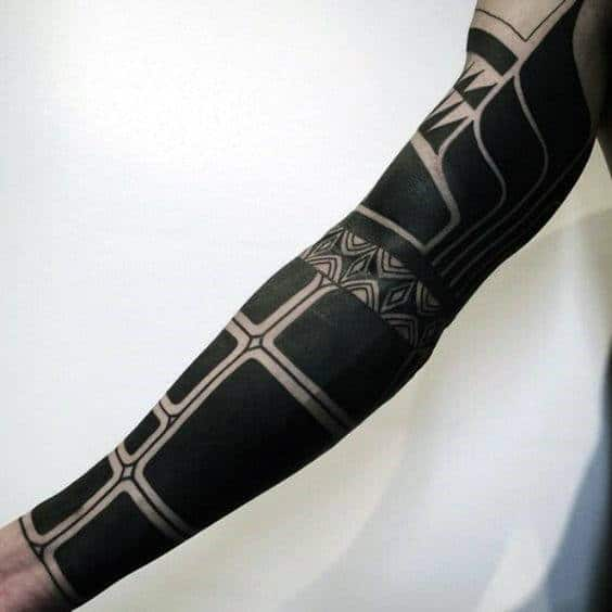 Man With Cool Blackwork Sleeve Tattoo