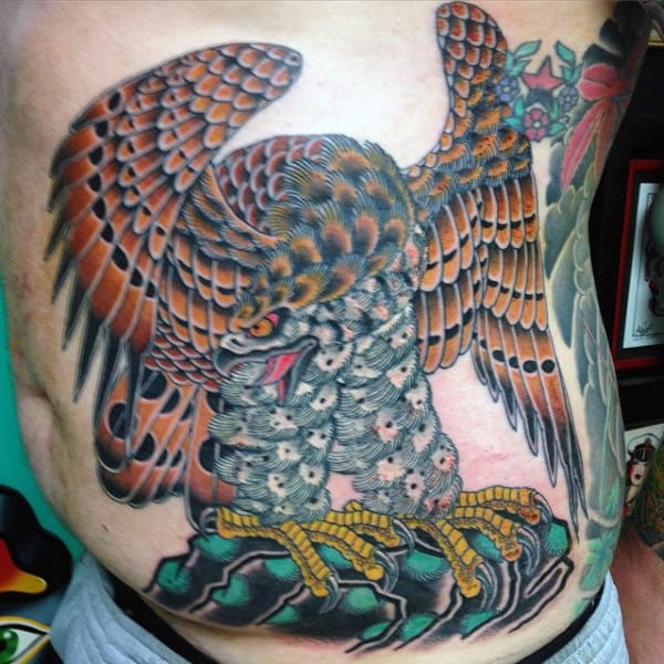 Man With Cool Colorful Stomach Tattoo Of Hawk