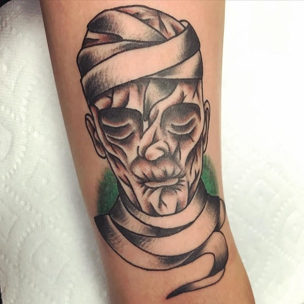 Man With Cool Mummy Portrait Tattoo On Arm