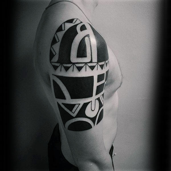 Man With Cool Tribal Arm Black Ink Tattoo Design