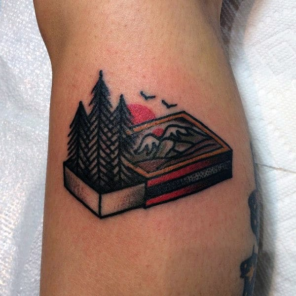 Man With Creative Calf Tattoo Forest In Matchbox