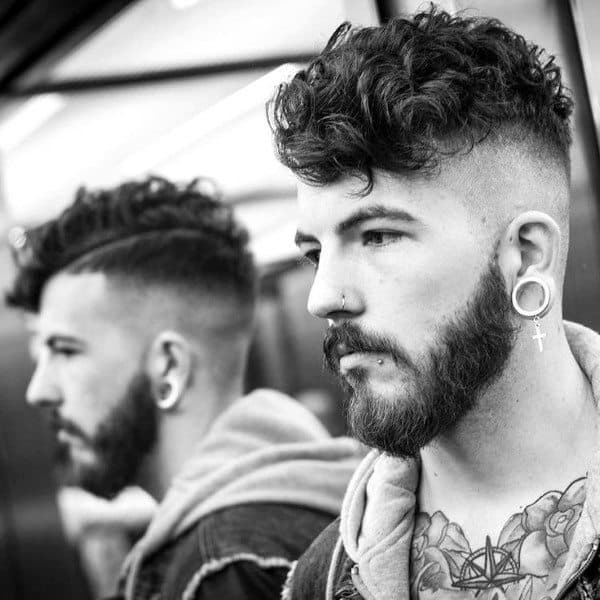 Man With Curly Undercut Hairstyle Medium Length