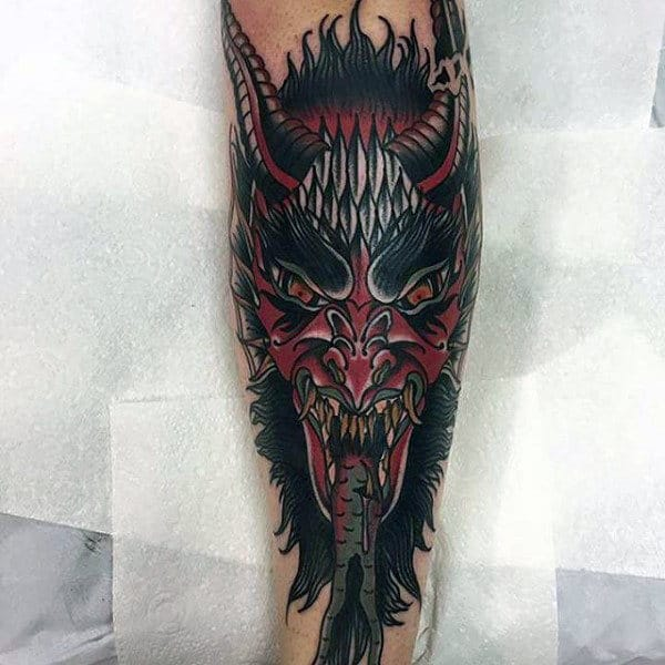 Man With Demon Shin Tattoo