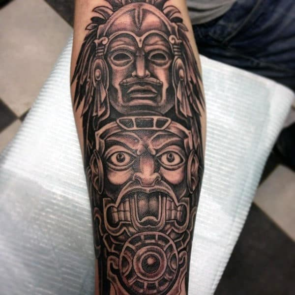 Man With Detailed Black Work Totem Pole Forearm Tattoo