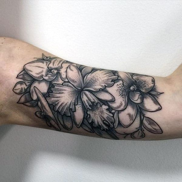 Man With Detailed Orchid Inner Arm Bicep Tattoos