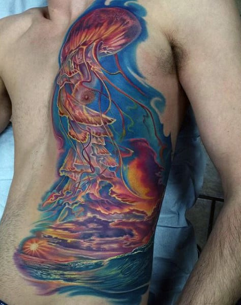 Man With Dramatic Color Side And Chest Sunset Ocean Tattoo