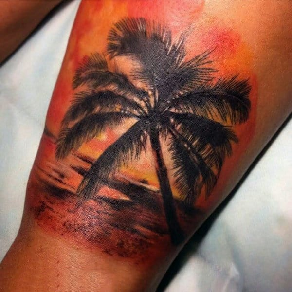 Man With Dramatic Palm Beach Sunset Tattoo On Thigh