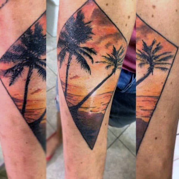 Man With Dramatic Palm Tree Sunset Tattoo On Forearm