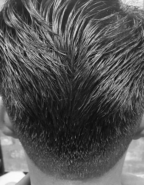 Man With Ducktail Hair Cut Medium Length