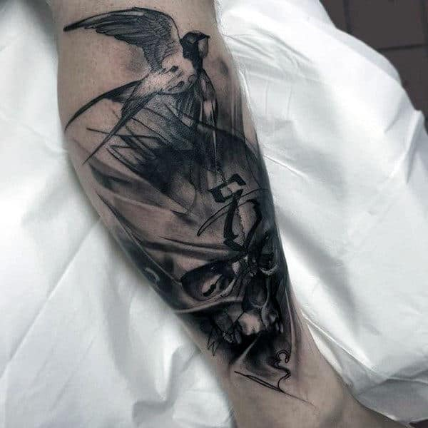 Man With Eerie Skull And Sparrow Tattoo Calves