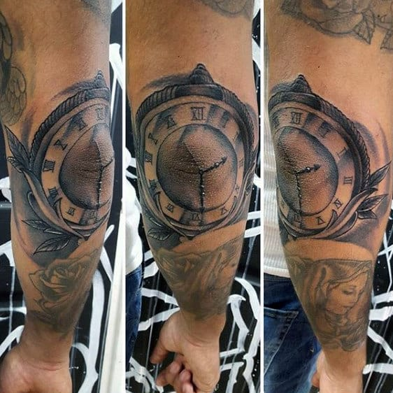Man With Elbow Clock Tattoos