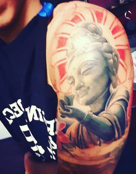 Man With Enlightened Buddha Tattoo On Arms