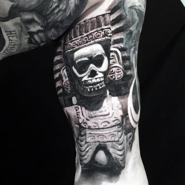 Man With Ethnic Idol Tattoo On Quarter Sleeves