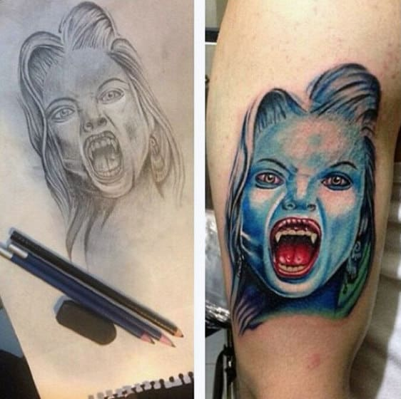 Man With Female Vampire Tattoo Design On Arm In Blue Ink