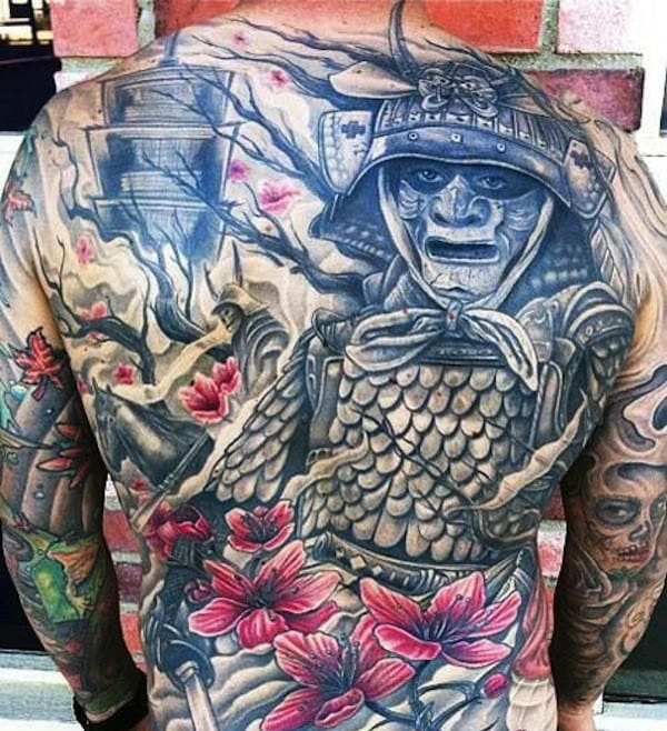 Man With Floral Flower Samurai Tattoo On Back