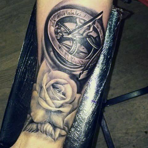 Man With Forearm Sleeve Tattoo Compass With Rose