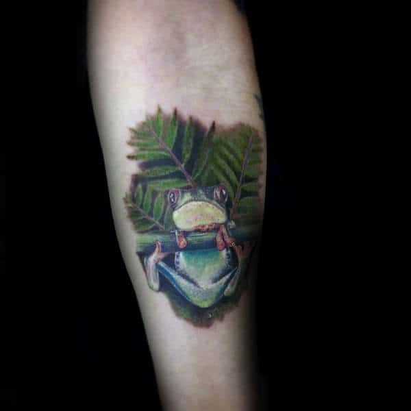 Man With Frog And Leaves Tattoo On Inner Forearm