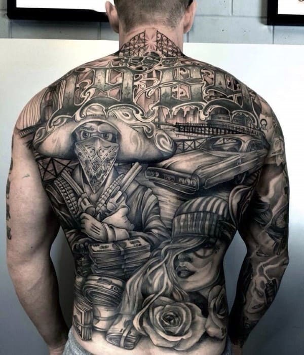 Man With Full Back Chicano Tattoo Designs