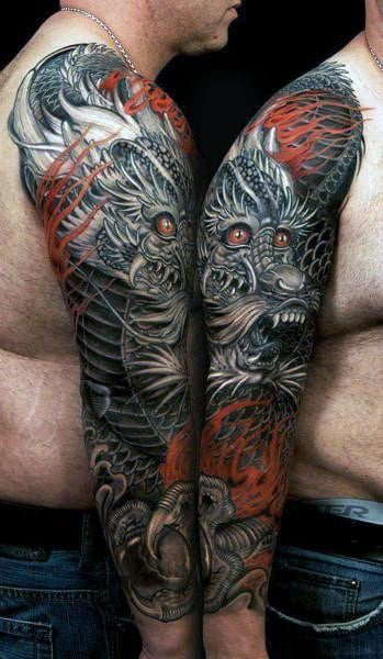 Man With Full Tattoo Sleeve Design Of Chinese Dragon