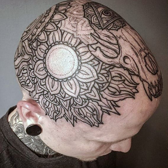 Man With Geometric Flower Head Tattoo Deisgn