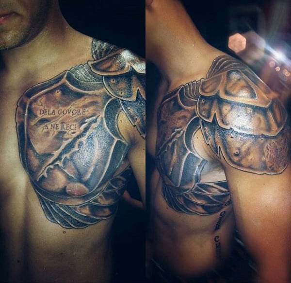 Man With Gladiator Games Tattoo On Shoulder