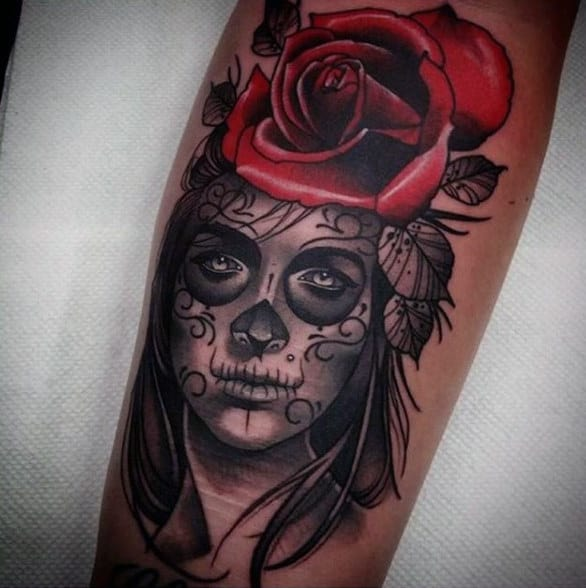 Man With Gorgeous Red Rose And Day Of The Dead Woman Tattoo On Forearm