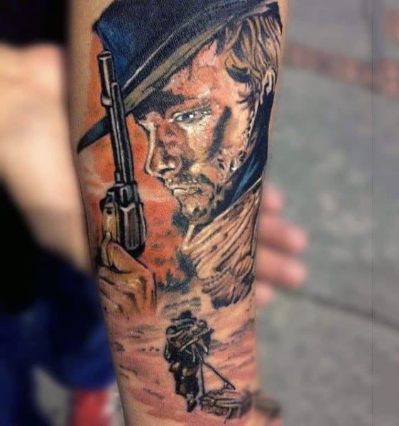 Man With Gorgeous Watercolor Tattoo Of Man Holding Pistol On Forearm
