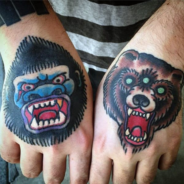 Man With Gorilla And Bear Tattoos On Hands