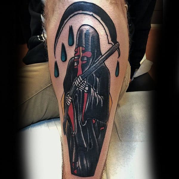 Man With Grim Reaper Shin Tattoos