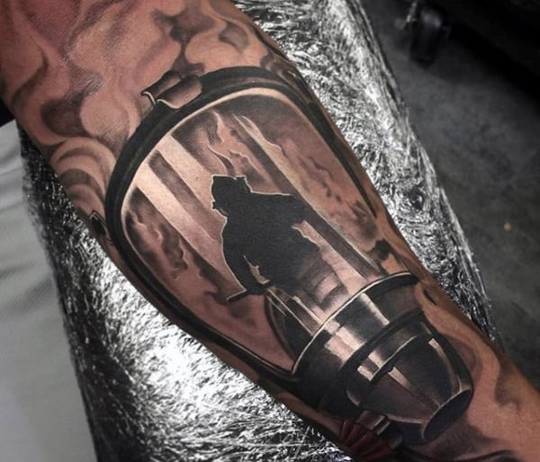 Man With Half Sleeve Mask Firefighter Tattoos