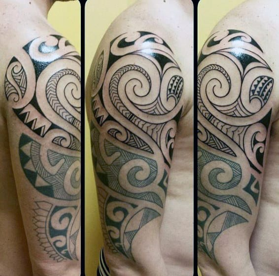 Man With Half Sleeve Of Maori Tattoo Design