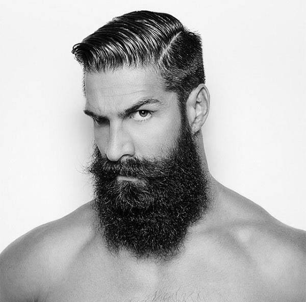 Man With Hard Part Hairstyle And Thick Beard