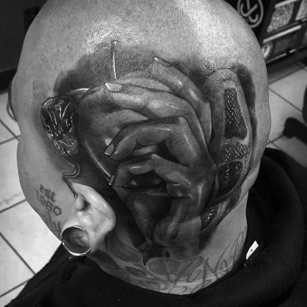 Man With Head Tattoo Of Hand Holding Apple And Snake